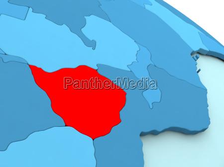 zimbabwe in red on blue globe