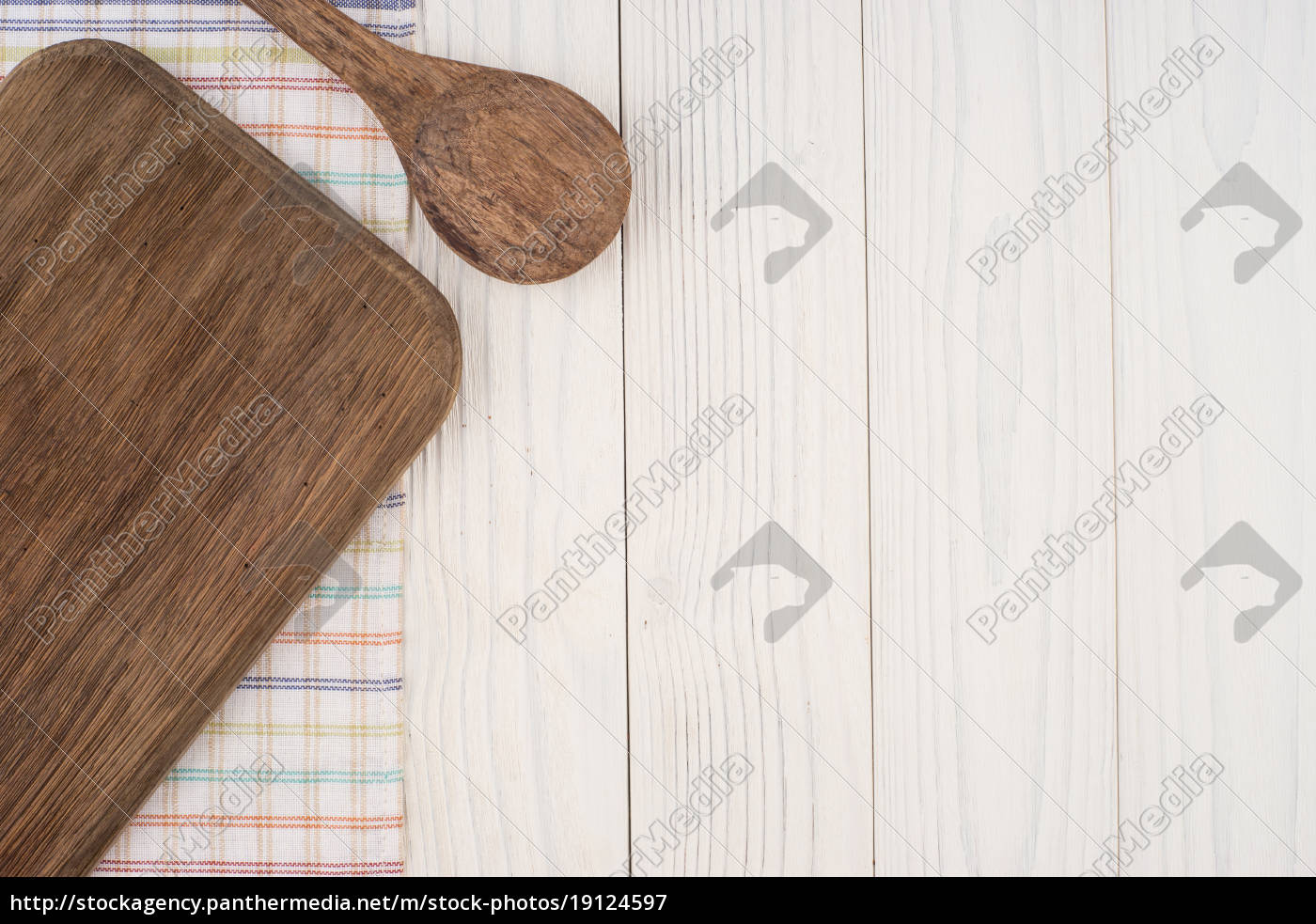 Stock Photo 19124597 - Cutting board and a spoon on a kitchen napkin on old  wooden