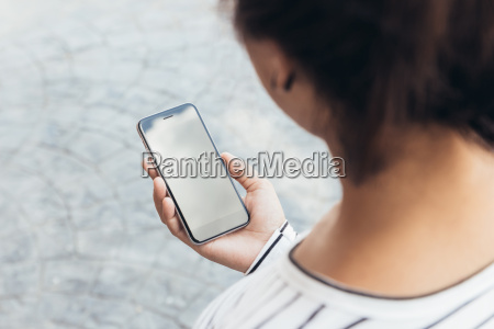 close up woman holding phone lifestyle