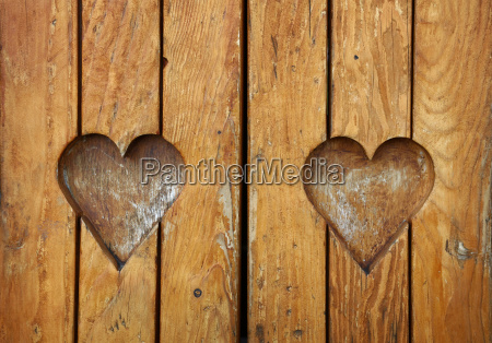 two heart shapes carved in vintage