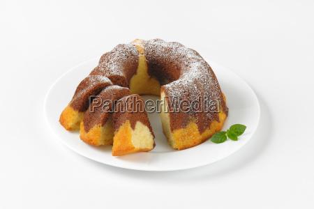 partially sliced marble bundt cake