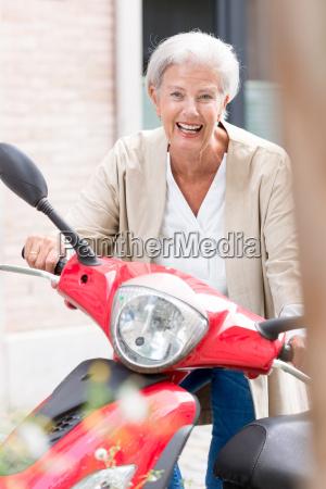 senior on scooter