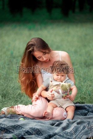 young beautiful mother sitting with her