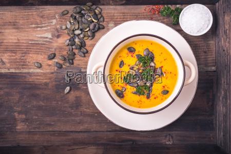 pumpkin soup with pumpkin seeds and