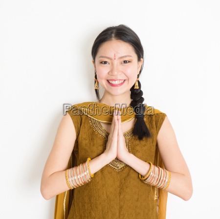 mixed race young indian woman greeting
