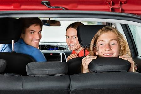 happy girl sitting in car