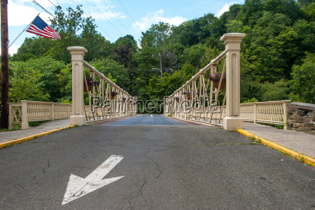 iron bridge with white arrow and
