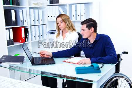 disabled business man and his female