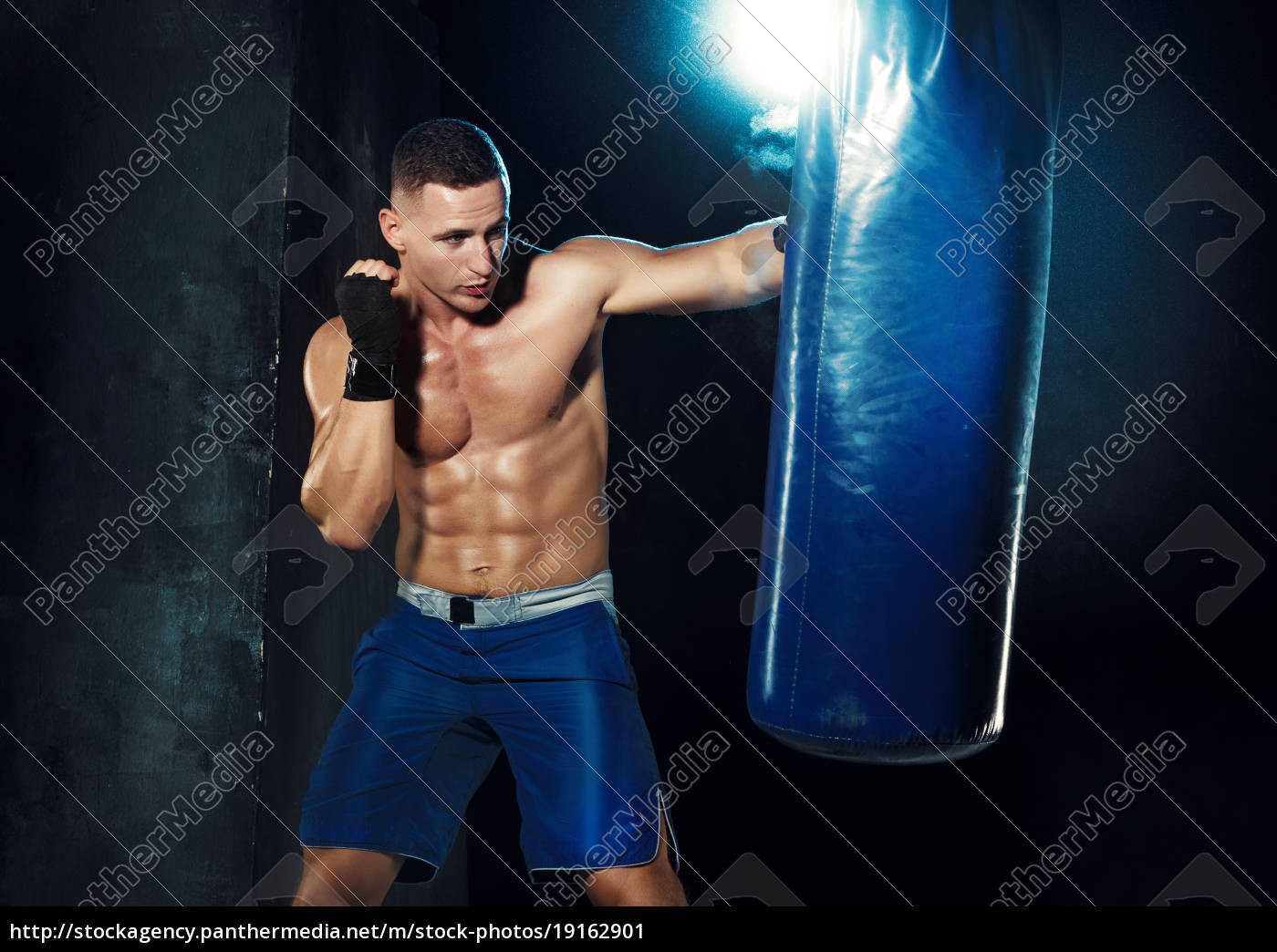 male, boxer, boxing, in, punching, bag - 19162901