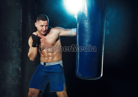 male, boxer, boxing, in, punching, bag - 19162903