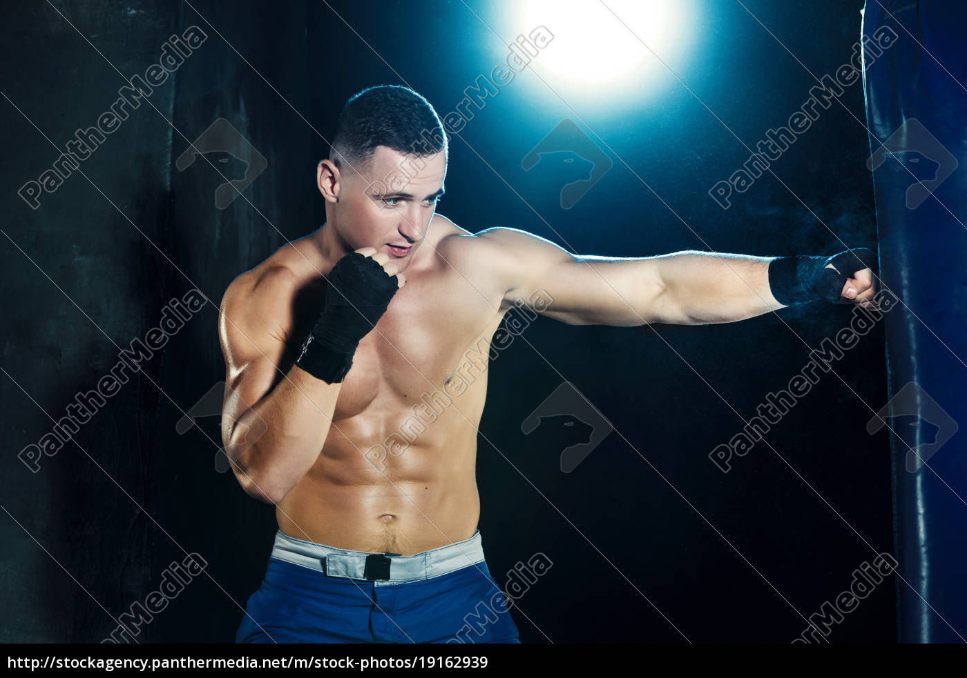 male, boxer, boxing, in, punching, bag - 19162939