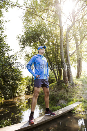 young, man, jogging, at, the, woods - 19164135