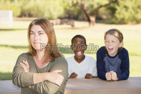 frustrated mother with children at park