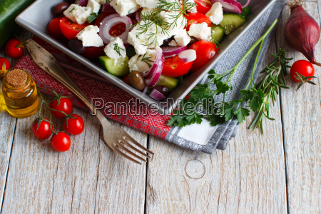 greek, salad, on, a, wooden, table - 19171127