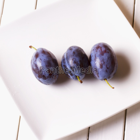 prunes over a white plate