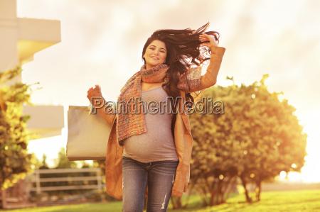 pregnant woman enjoying shopping