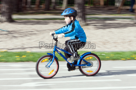 child on a bicycle at asphalt