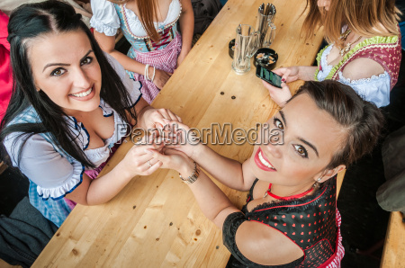 two attractive women at oktoberfest with