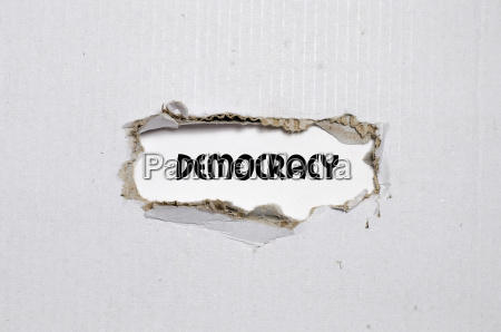 the word democracy appearing behind torn