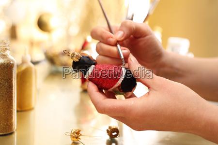 decorating christmas balls brush woman paints