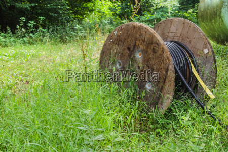 industrial cable reel on a meadow