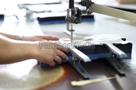 cutting the fabric working in the