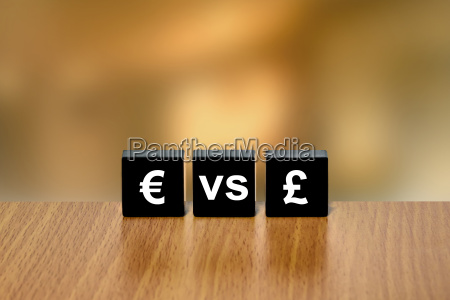 euro versus pound currency on black
