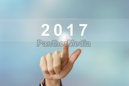 business hand clicking 2017 button on