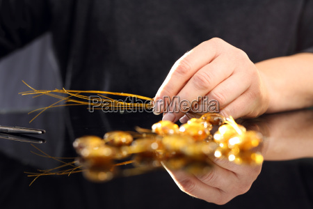 manufactory, a, woman, carries, amber, jewelry - 19211657