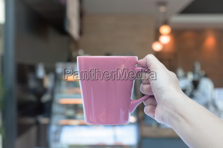woman hands holding coffee cup with