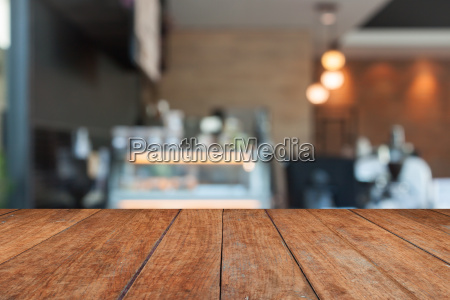 perspective brown wood with blurred coffee