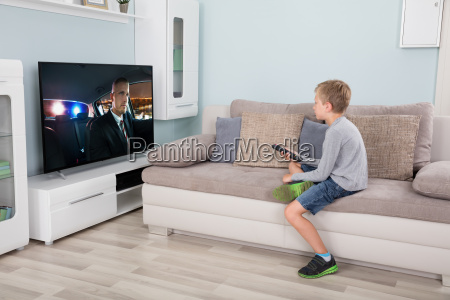 boy with remote control in front