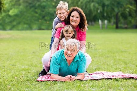 portrait of happy grandparent and grandchildren