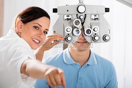 female optometrist doing sight testing for