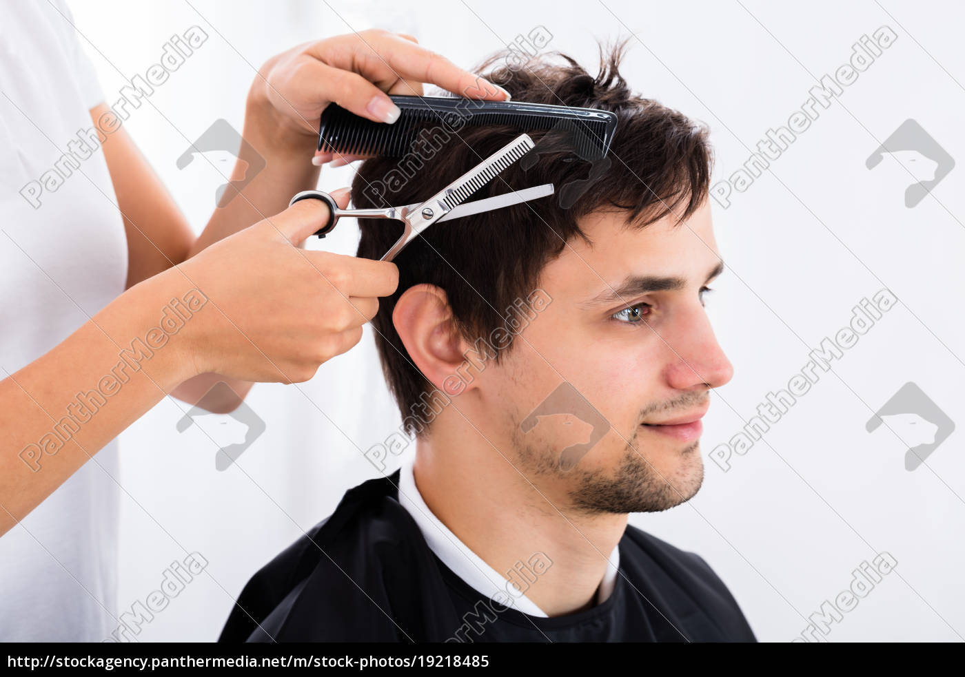 man, getting, haircut, from, hairdresser - 19218485