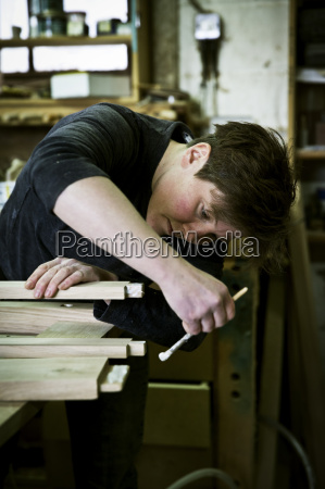 a woman working in a furniture