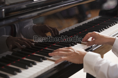 close up of a pianists hands