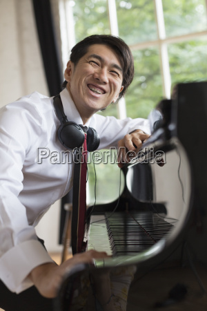 young smiling man sitting at a