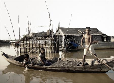 children in boat on river