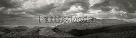 dramatic sky over a vast mountainous