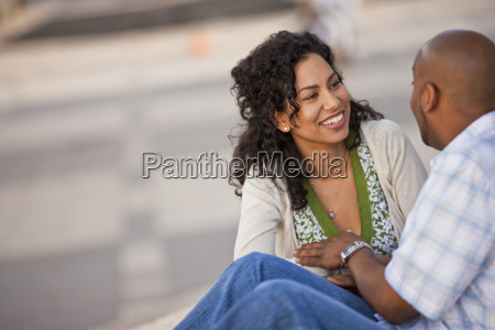 happy young woman smiling at her