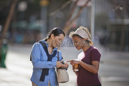 happy mid adult woman talking while