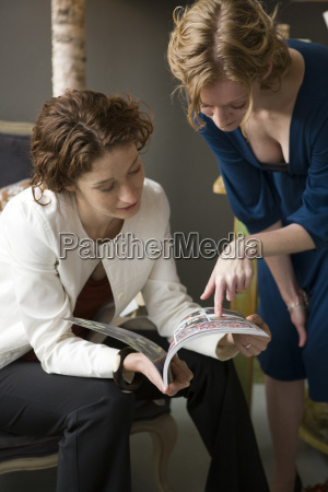 two women reading a book