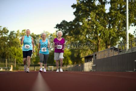 happy senior women walking on an