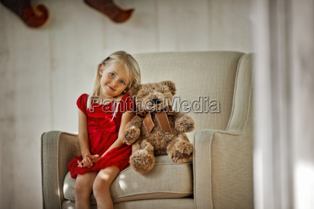 young girl sitting on an armchair