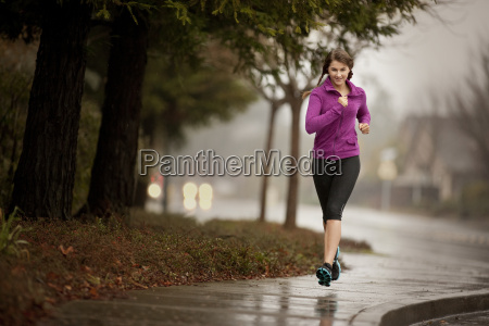 young woman jogging on a residential