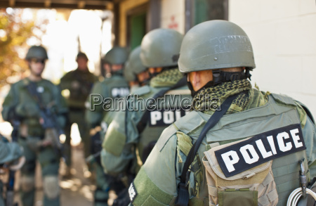 team of armed military police holding