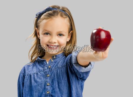 cute, girl, holding, an, apple - 19240847