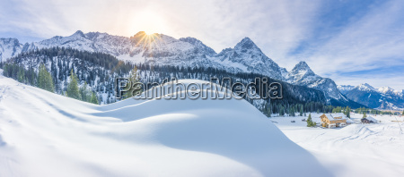 mountain village and snowy alps