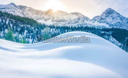 snowy mountains and piles of snow